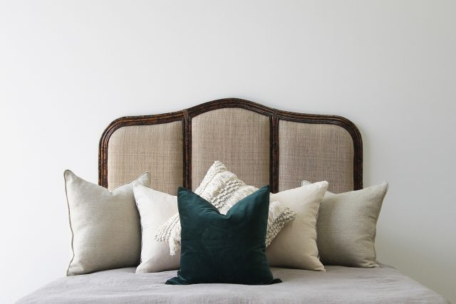 Rattan upholstered bedhead